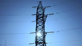 High voltage electric transmission line and pylon against cityline and distribution transformer substation