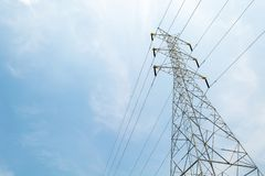 High Voltage Electric Transmission Tower Energy Pylon against royalty free stock image