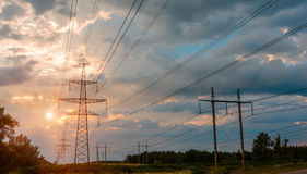 High Voltage Electric Transmission Tower Energy Pylon. High-voltage power lines at sunset. electricity distribution station. high voltage electric transmission royalty free stock photography