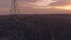 High Voltage Electric Transmission Tower Energy Pylon. Sunset.