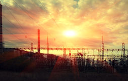 High voltage electric transmission tower at sunset. High-voltage  power lines at sunset. electricity distribution station. high voltage electric transmission Stock Photos