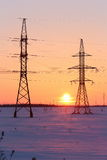 High-voltage electric wire on the background of beautiful sunset Stock Photography