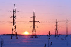 High-voltage electric wire at sunset Royalty Free Stock Image