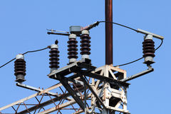 High-voltage electrical insulator. Shot of High-voltage electrical insulator electric line against the blue sky Stock Images