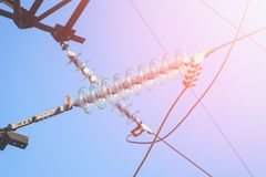 High-voltage electrical insulator. Electric line against the dark blue sky Royalty Free Stock Photos