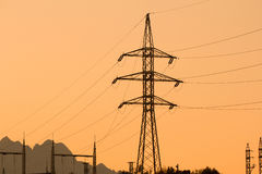 High voltage electrical pole sunset silhouette Stock Photos