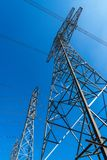 High voltage electrical power lines and clear blue sky royalty free stock photo