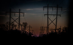 High Voltage Electrical Power lines and Support Poles Stock Photo