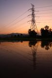 High voltage electrical pylons. And wires on sunset background Royalty Free Stock Photos