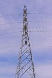 High voltage electrical tower against blue sky background Royalty Free Stock Photography