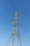 High-voltage electrical tower against the sky stock image