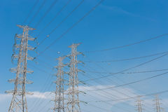 High voltage electrical tower blue sky background. High voltage electrical tower background royalty free stock photo