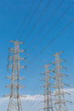 High voltage electrical tower blue sky background. High voltage electrical tower background stock images