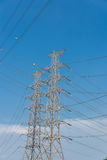 High voltage electrical tower blue sky background. High voltage electrical tower background Royalty Free Stock Images