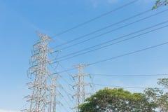 High voltage electrical tower blue sky background. High voltage electrical tower background Stock Photos