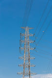 High voltage electrical tower blue sky background. High voltage electrical tower background Royalty Free Stock Photography