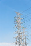 High voltage electrical tower blue sky background. High voltage electrical tower background royalty free stock photos