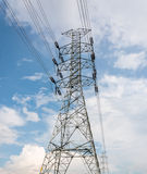 High voltage electrical towers in line. On blue sky Stock Photo