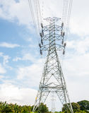 High voltage electrical towers in line. On blue sky Stock Photography