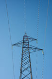 High voltage electricity cables  over a blue sky Stock Photography
