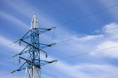 High voltage electricity feeder. On the blue sky bacground Stock Photos