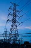 High voltage electricity pillars and blue sky Royalty Free Stock Photos