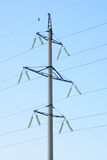 High voltage electricity pillars  on the blue  sky background Royalty Free Stock Photography