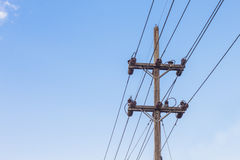 High voltage electricity pole with blue sky background Royalty Free Stock Photos