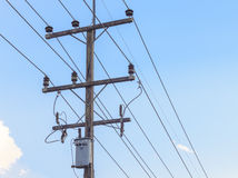 High voltage electricity pole with blue sky background Royalty Free Stock Images