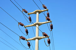 High voltage electricity pole. With blue sky background Royalty Free Stock Photography