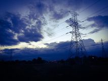 High-voltage electricity pole. And sunset at Royalty Free Stock Photo