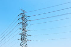 high voltage electricity post with cables and blue sky Stock Photo