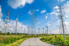 High voltage electricity pylon with blue sky background Stock Photos