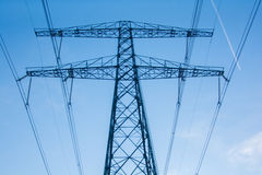 High voltage electricity pylon in blue sky Stock Photography