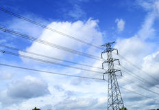 High voltage electricity pylon on bright sky Royalty Free Stock Images