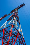 High-voltage electricity pylon and power lines against blue sky Stock Photography