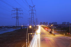 High voltage electricity pylon in side of highway Royalty Free Stock Photos