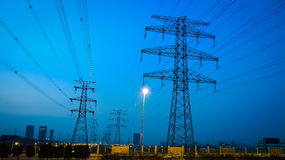 The high voltage electricity pylon in side of highway Stock Images