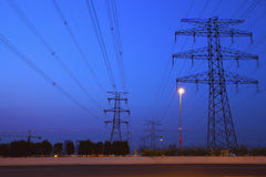 The high voltage electricity pylon in side of highway Stock Photo