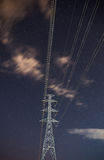High voltage electricity pylon star sky Stock Images