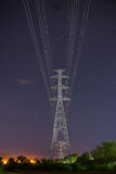 High voltage electricity pylon star sky Royalty Free Stock Photography