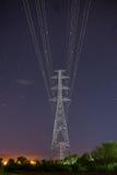 High voltage electricity pylon star sky Royalty Free Stock Photography