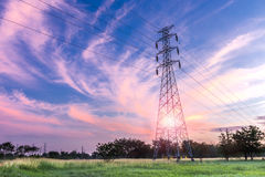 High voltage electricity pylon on sunrise background.  Royalty Free Stock Photography