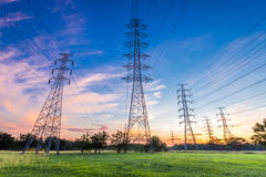 High voltage electricity pylon on sunrise background Royalty Free Stock Photos