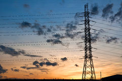 High voltage electricity pylon on sunset Royalty Free Stock Photography