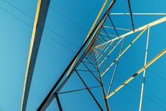 High voltage electricity pylon with wires, low wide angle view Royalty Free Stock Photography