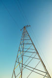 High voltage electricity pylon with wires, low wide angle view Royalty Free Stock Photo
