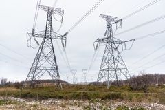 High Voltage Electricity Pylons on a Winter Day Royalty Free Stock Image