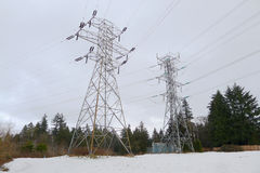High Voltage Electricity Pylons on the Snow. This is taken in Delta, BC, Canada Royalty Free Stock Photo