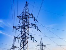 Image of high voltage power line and sky. High voltage electricity pylons and transmission power lines on the blue sky background Stock Images